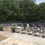 outside wedding black chairs